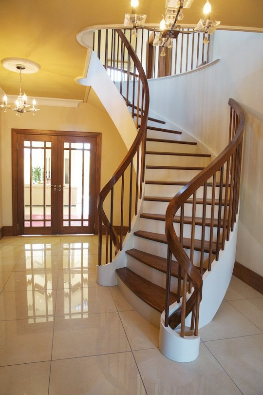 Painted curved stairs with Walnut Handrail, Spindles & Treads