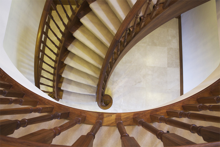 Walnut Curved Staircase featuring Helical wrap strings and matching volutes