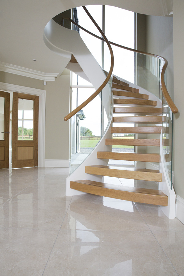Bespoke Curved Staircase featuring White Oak & Painted mix with Curved Glass